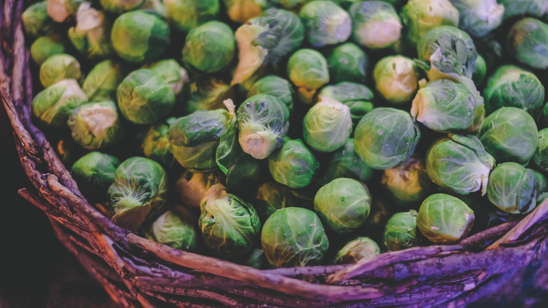 Basket of bright green, sphere shaped brussels sprouts
